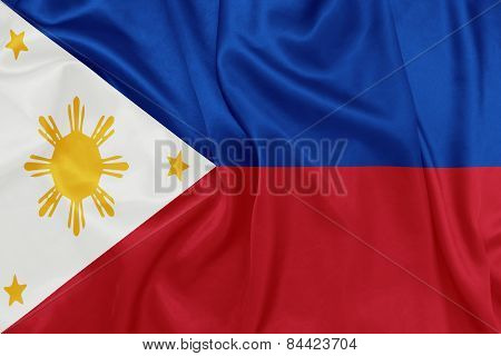 The Phillipines - Waving national flag on silk texture