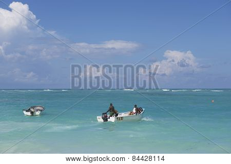 People ride a taxi boat in Punto Cana, Dominican Republic.