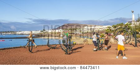 : People Train At The Outdoor Fitness Station