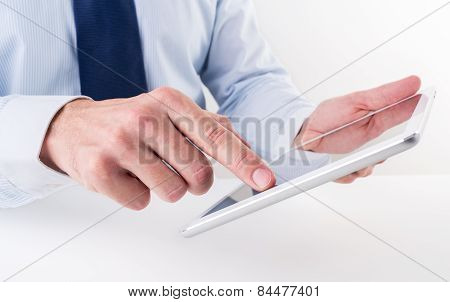 Businessman using a digital tablet.