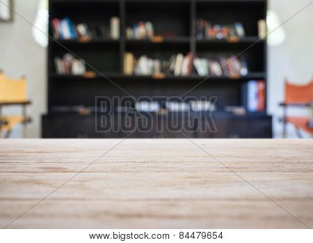Table Top With Blurred Book Shelf Interior Background
