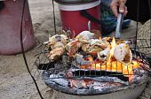 Various shellfish on the grill at the beach in Nha Trang in Vietnam poster