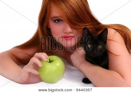young teenager with apple and cats