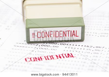 The confidential stamped on the bank statement poster