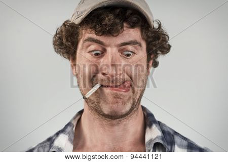 Hungry redneck licks his lips while smoking a cigarette poster