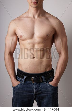 toned male torso with muscular arms and sixpack fitness or bodybuilding concept poster