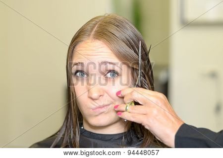 Young Woman Giving The Hairdresser A Dubious Look