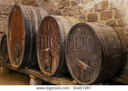 four cider or wine barrels
