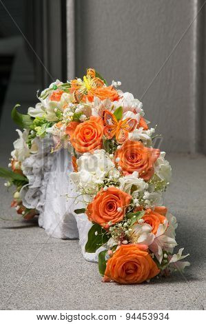 Bridal Bouquet With Orange Roses And Butterfly