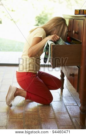 Woman Searching For Something In Drawers