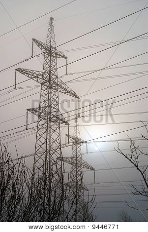 Line Of Electricity Transmissions On A Background Sunset