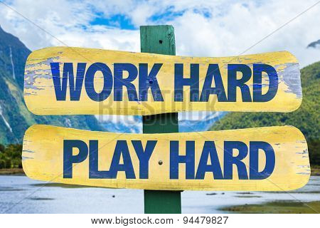Work Hard Play Hard sign with mountains background