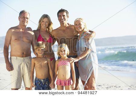 Three Generation Family On Beach Holiday