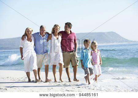 Three Generation Family Walking Along Beach