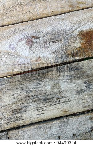 Old wooden planks pale tiles diagonally.