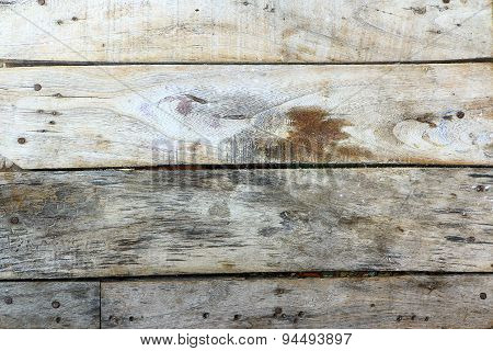 Old wooden planks arranged horizontally.