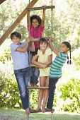 Group Of Children Climbing Rope Ladder To Treehouse poster