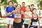Female Athlete Winning Marathon Race poster