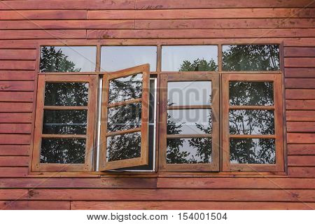 vintage wood window open with reflex of mirror