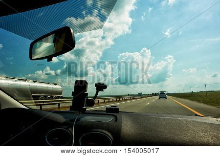 The road to the South. The view from the interior of the car on the road. Mirror, clouds. M4 Don
