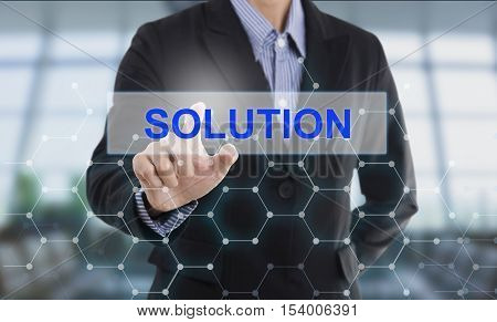 Businessman hand pressing button solution. sign on virtual screen. business concept.