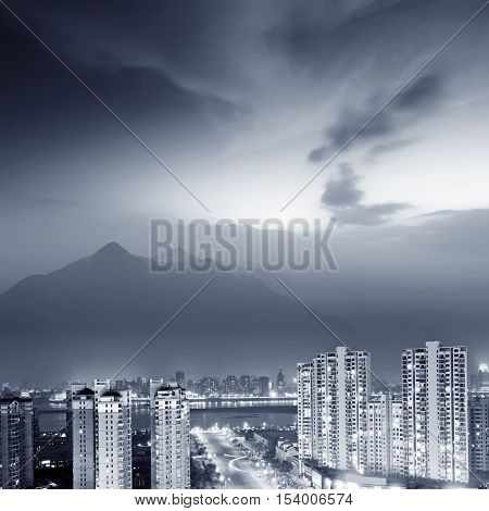 Aerial view of modern city skyscrapers and road night view.