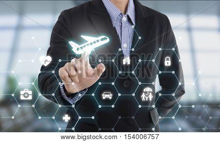 business salesman agent hand pressing button protection plane concept travel insurance.