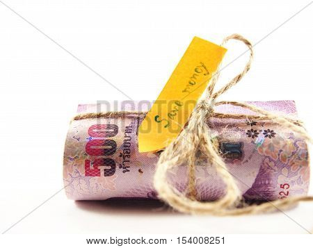 Rolled notes rope ribbon by brown string save money, concept isolated on white background
