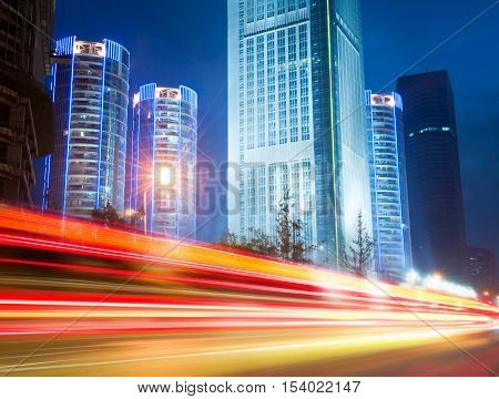 The light trails on the modern building background in shanghai china.
