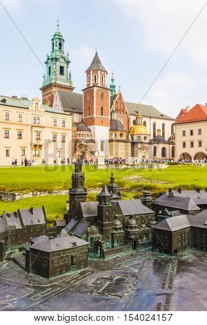 Krakow Poland - September 7 2016: A model of Wawel castle with the original Royal Archcathedral Basilica of Saints Stanislaus and Wenceslaus and other building of the castle on the background.