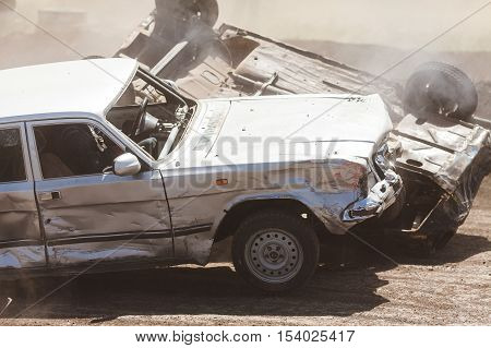 collision of two cars. road and transport accident. car crash accident on street, damaged automobiles after collision in city.