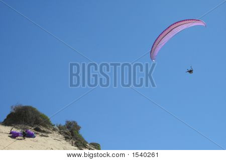 Two Paragliders - One Up And Away