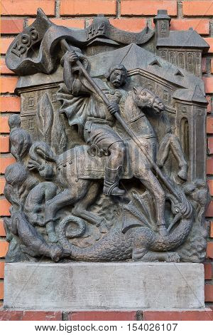Mukachevo Ukraine - July 21: a bas-relief on the wall closeup with the image of St. George slaying the dragon July 21 2016 in Mukachevo Ukraine