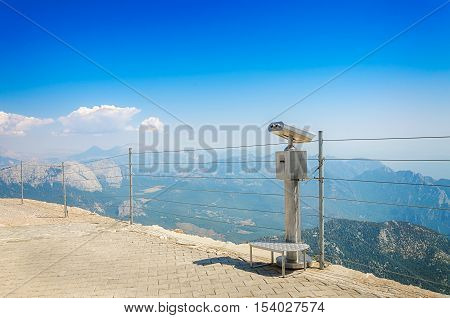 Observation deck with coin-operated telescope or binocular on top of mount Tahtali Kemer Antalya province Turkey. Bright sunny day.