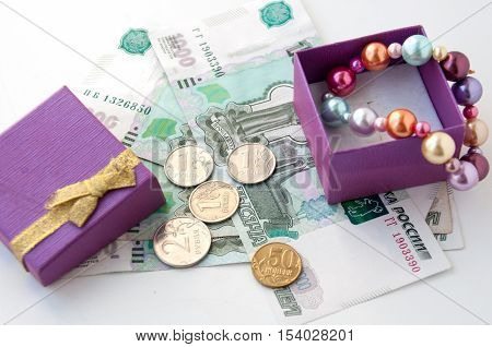 Box with colored pearls and Russian money