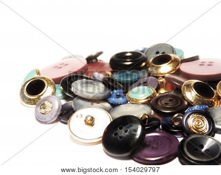Multicolored sewing buttons, heap of buttons. Isolated on white background.