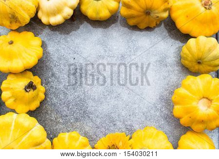 Bunches of squash as a natural border around blank area with copy space on table