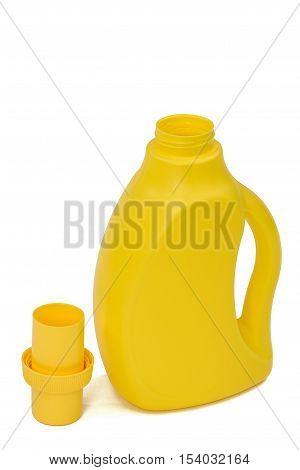 Yellow plastic bottle with a dispenser in cap isolated on white background. Detergent for ware and cleaning in kitchen.