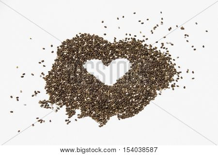 Chia seeds isolated on a white background forming a heart.
