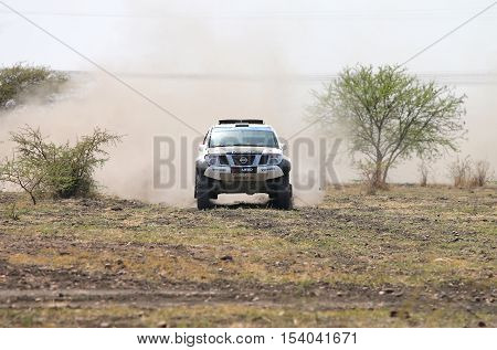 Front View Close-up Of Racing Black And White Nissan Navara Rally Car