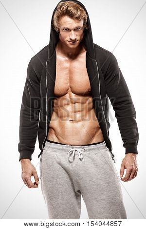 Strong Athletic Muscle Man Showing Abdominal Muscles In Jacket