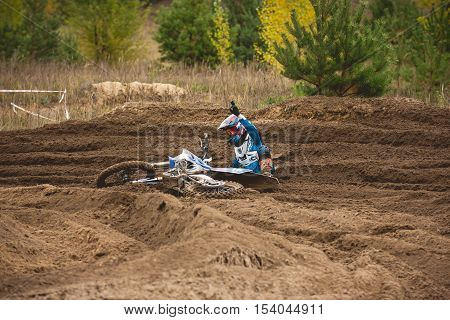 24 september 2016 - Volgsk, Russia, MX moto cross racing - motorcycle rider fell, telephoto