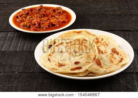 -Paratha with spicy and tasty mutton curry.