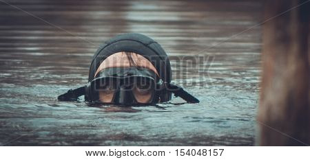 portrait of a diver floated to the ake surface, telephoto