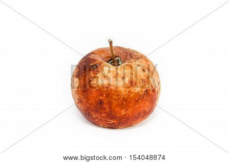 It is a rotten apple on a white background