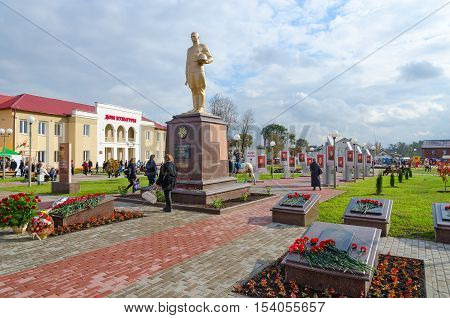 SENNO BELARUS - OCTOBER 8 2016: Alley of Heroes and House of Culture Senno Vitebsk region Belarus. Unidentified people walk on central town square during event Dozhinki-2016