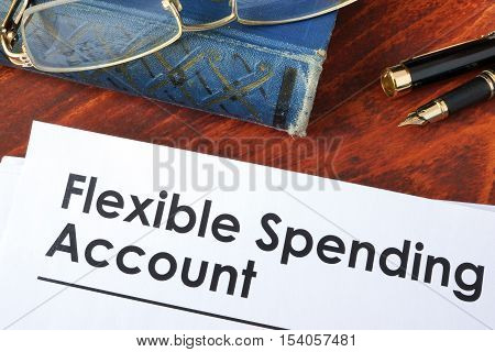 Papers with flexible spending account FSA on a table. poster