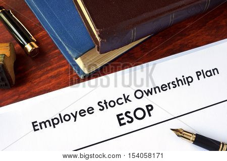 Papers with Employee Stock Ownership Plan (ESOP) on a table.