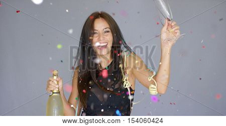 Laughing vivacious woman celebrating the New year