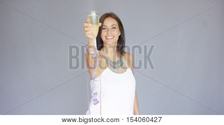 Beautiful chic young woman toasting the New Year